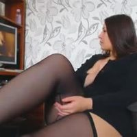 A woman with beautiful curves masturbates watching a porno